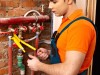 Men builder fixing heating system .